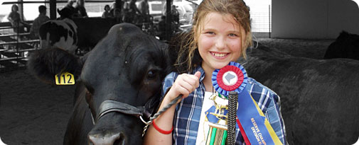 Photo of girl with cattle at the fair.