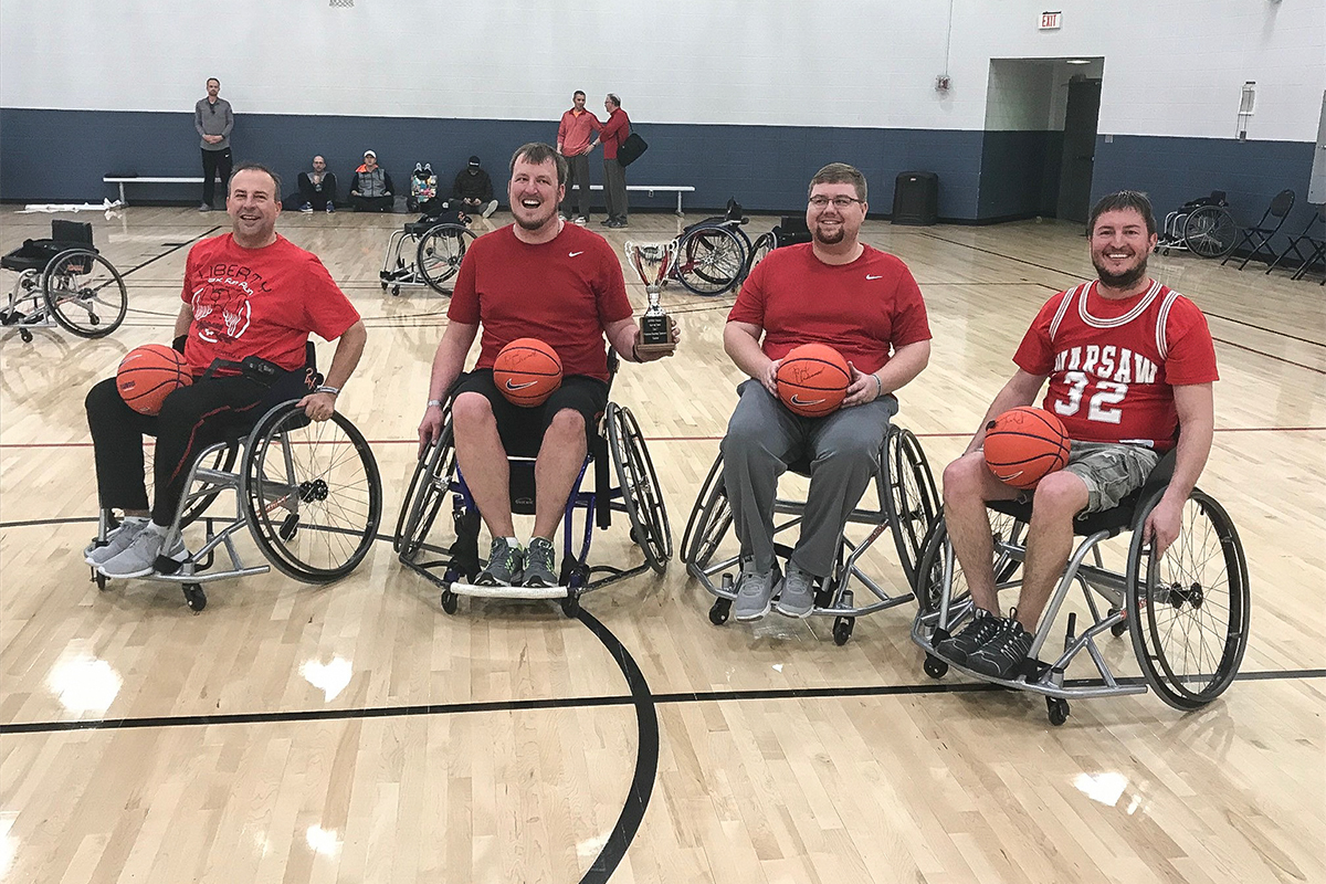 Four wheelchair basketball players