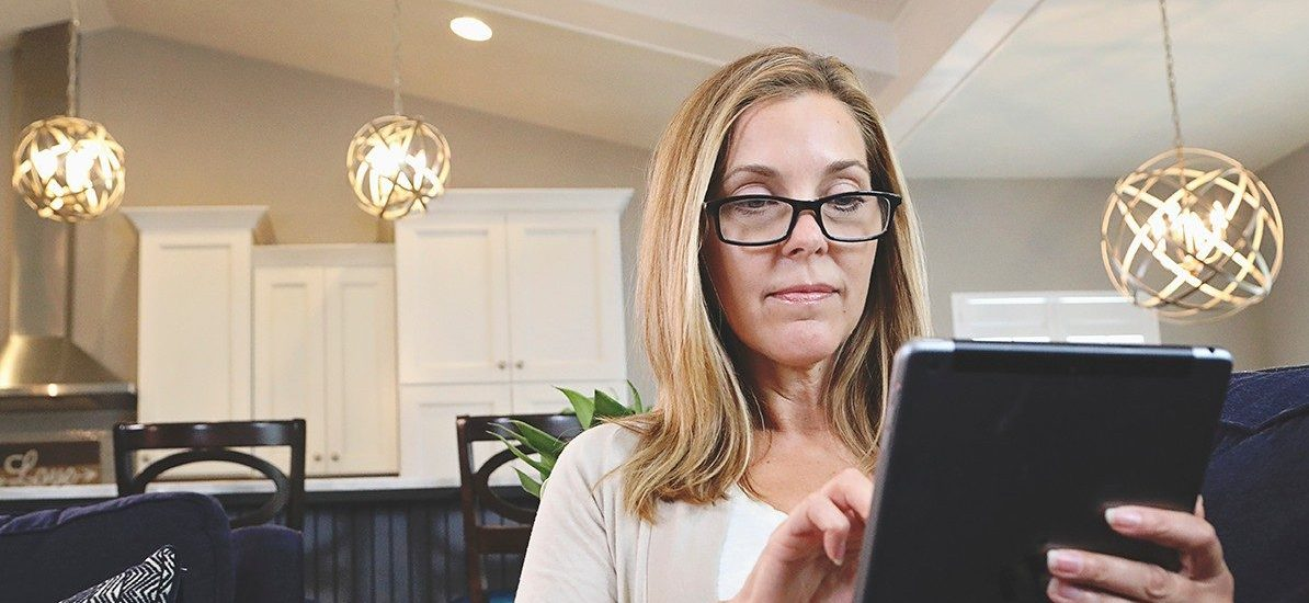 Woman with a tablet looking for insurance